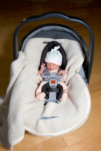 1 week old pre-mature girl in car seat